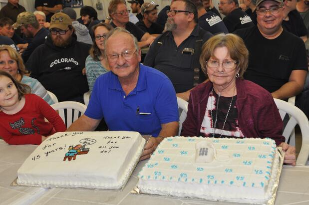 Alvin, his wife, and his two 45-year-anniversary cakes from Scotchman!